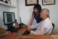 Dr. Mark Souweidane reviews MRI scans of DIPG tumors with Fatima Nathalia Morales.